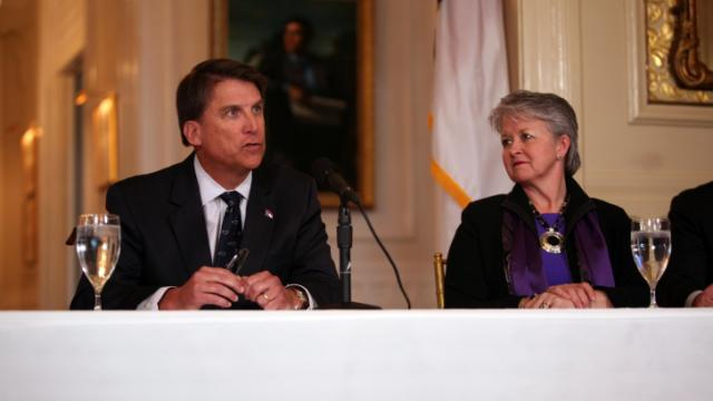 Secretary of Commerce Sharon Decker listens to Gov. Pat McCrory speak at a news conference at the Governor's Mansion on Jan. 21, 2014.