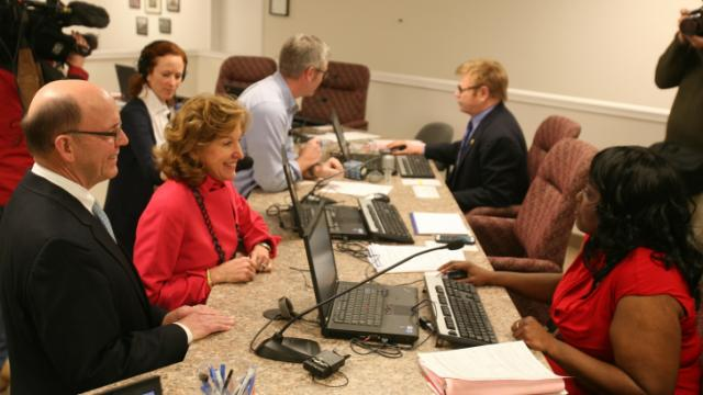 "Sen. Kay Hagan, D-NC, files paperwork needed to file for re-election as her husband, Charles ""Chip"" Hagan, looks on."
