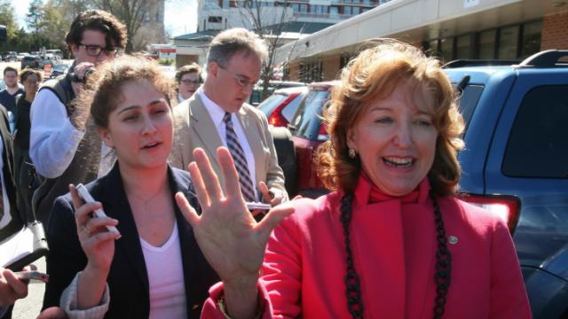 Sen. Kay Hagan, flanked by campaign staffer Sadie Weiner, leaves the N.C. Board of Elections office on Feb. 24, 2014, after filing to run for re-election.
