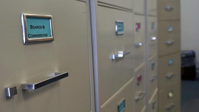 Cabinets filled with statement of economic interest forms line the wall inside the State Ethics Commission building, located on Blount Street in Raleigh.