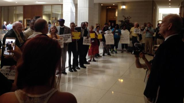 Protesters gather outside House Speaker Thom Tillis' office on May 27, 2014. (Photo by Laura Leslie)