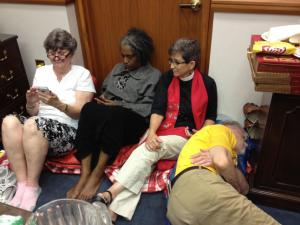 Protesters roll out sleeping bags during a sit-in at Speaker of the House Thom Tillis' office on May 27, 2014. (Laura Leslie/WRAL)