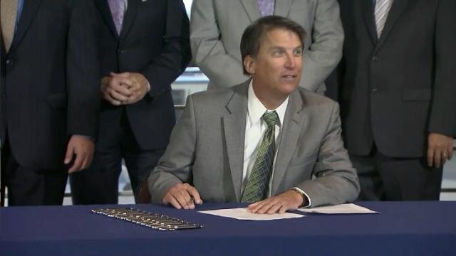 Gov. Pat McCrory signed legislation on June 4, 2014, that would speed up the start of natural gas drilling in North Carolina.