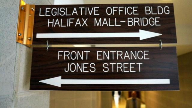 This is a picture of a sign in the hallway of the legislative building.