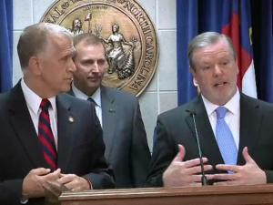 House Speaker Thom Tillis, left, and Senate President Pro Tem Phil Berger discuss a compromise budget during a July 29, 2014, news conference.