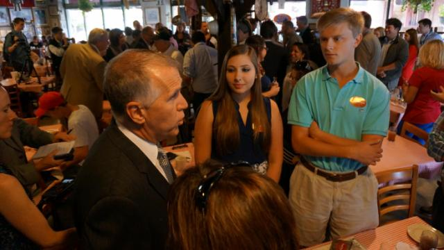 State House Speaker Thom Tillis talks with supporters of his U.S. Senate campaign at Big Ed's restaurant in City Market on Oct. 1, 2014.