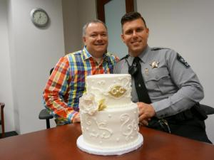 Cary bakery Simply Cakes gave a wedding cake to Chris Creech and Chad Biggs, both employees of the Wake County Sheriff's Office who are waiting to get married after an eight-year relationship.