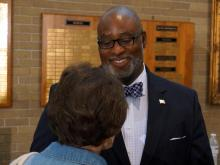Jonathan Barfield speaks to supporters after a 2014 candidates' debate.