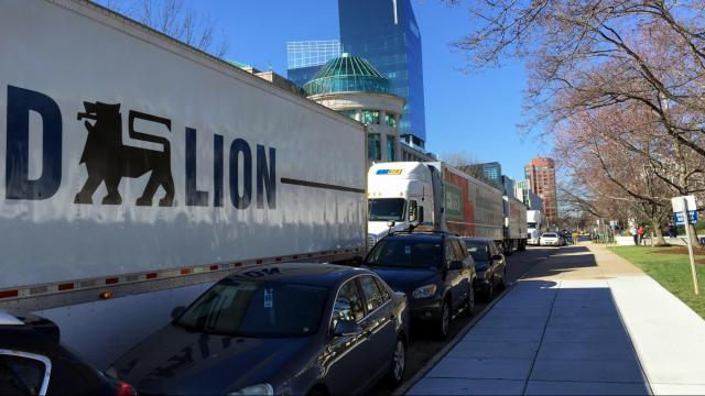 Tractor-trailers line up in front of the General Assembly to represent in-kind donations from retailers to the state's food bank network.