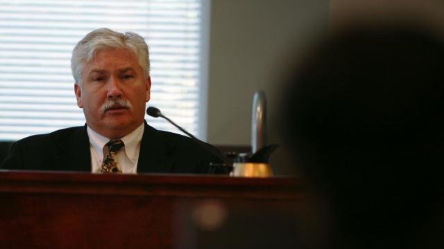 Michael Youron, formerly a psychological services coordinator at Alexander Correctional Institution, testifies in a personnel hearing in March 2015. Youron contested his firing following the death of inmate Michael Anthony Kerr (Tyler Dukes/WRAL).