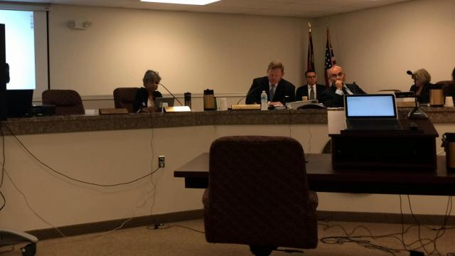 SBOE member Paul Foley was absent from a state board meeting the day Gov. Pat McCrory called for him to step down from the panel.
