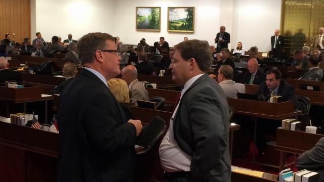 House Speaker Tim Moore, R-Cleveland, talks with Budget Chairman Nelson Dollar, R-Wake, Tuesday, Aug. 11, 2015.