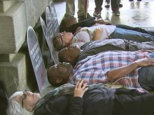 """Demonstrators hold a """"die-in"""" outside the State Capitol on Oct. 28, 2015, to protest state lawmakers' refusal to expand the Medicaid health insurance program for the poor and disabled."""
