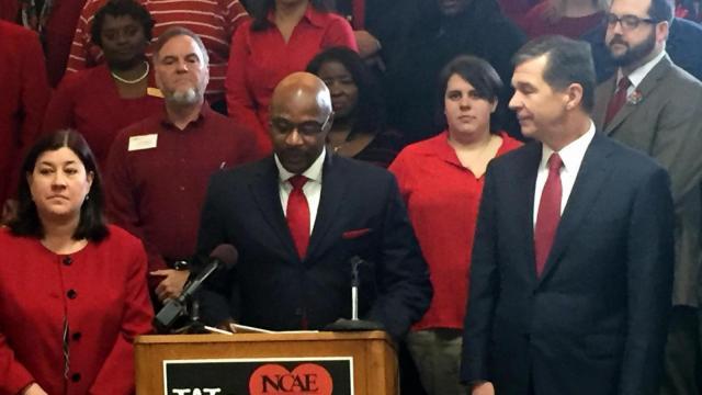 NCAE President Rodney Ellis, center, announces the group's endorsement of Democrat Roy Cooper for governor in 2016.