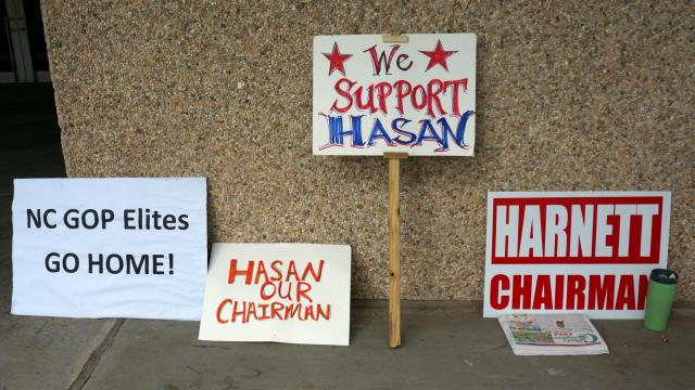 Signs supporting Hasan Harnett sit outside the McKimmon Center on Saturday as members of the North Carolina Republican Party's executive committee meet to decide whether to remove him as chairman.