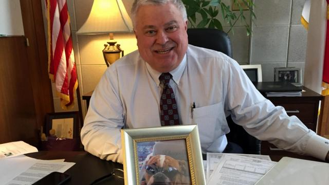 Sen. Tom Apodaca, R-Henderson, sits in his legislative office with a picture of his dog, Raleigh.