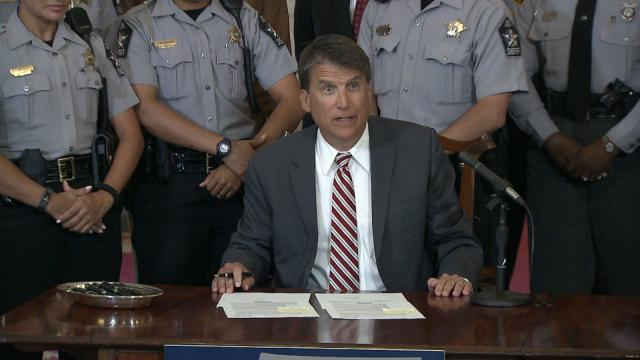 Gov. Pat McCrory signs legislation on July 11, 2016, that sets rules for access to footage from police body and dashboard cameras.