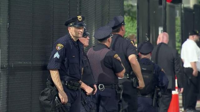 Hundreds of officers, miles of fences separate protesters, convention