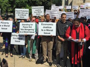 """Triangle area clergy and activists gathered outside the old state capitol building Monday to call on voters to help them """"redefine morality"""" in politics."""