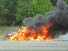 Emergency crews blocked the right lanes of Interstate 540 east Thursday morning after a car burst into flames on the shoulder near Aviation Parkway.