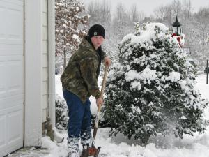 andrew spain shoveling snow from the driveway