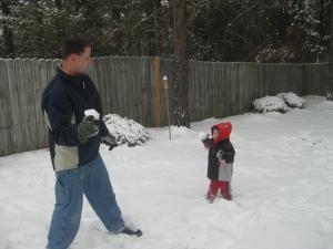 snow storm 1.10.2011  Benjamin Tremmel, age 2. Having a snowball fight with his daddy, Rodney Tremmel.