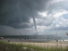 WRAL viewers share their photos of at least one waterspout that formed off Carolina Beach on Thursday, Aug. 18, 2011.