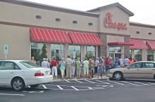 """Customers responded to a social media invitation for """"National Chick-fil-A Appreciation Day"""" in support of the company president's stance against gay marriage."""