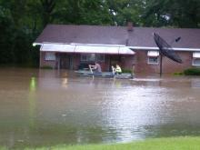 rescuing 2 ppl from their home on Glover St in Roanoke Rapids