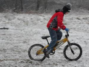 A boy rides his bike in the snow in Semora.