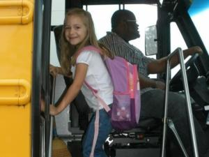 Emma Proctor getting on the bus for the first time to head off to school at Red Oak Elementary!
