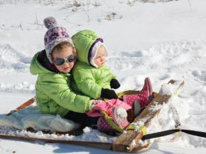 Emma and Sam having fun in the snow in Clinton.