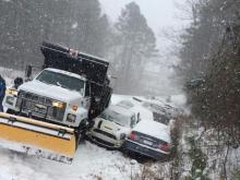 Snow and ice swept the state Wednesday afternoon, bringing traffic to a halt.