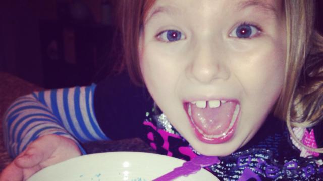 Arianna enjoying snow cream with sprinkles!
