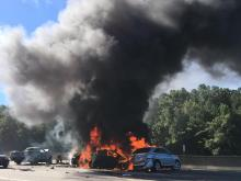 Cars on fire closed westbound lanes of Interstate 40 in Durham Monday morning. The state Department of Transportation estimated that the lanes would be closed until about noon.