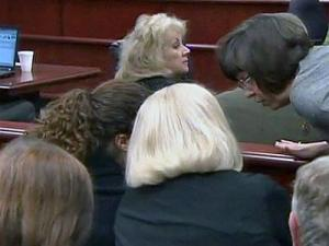 Wake County Assistant District Attorney Becky Holt speaks to Michelle Young's sister and mother on June 27, 2011, after the jury sent a note to the judge informing him that it is deadlocked in Jason Young's first-degree murder trial.