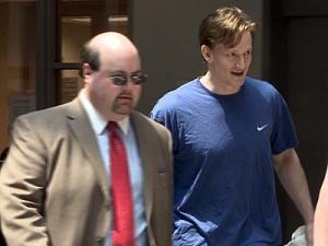 Jason Young walks out of the Wake County magistrate's office on July 28, 2011, after being released on a $900,000 secured bond.
