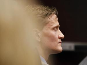 Jason Young listens during his retrial on March 5, 2012, as Judge Donald Stephens reads the verdict after a jury unanimously found him guilty of killing his wife Michelle Young. Michelle was several months pregnant when her sister found her body on November 3, 2006, in the master bedroom of the family's suburban Wake County home. In June, Superior Court Judge Donald Stephens declared a mistrial after a hung jury failed to reach a verdict. (Photo by Shawn Rocco, The News & Observer, Pool)