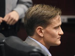 Jason Young listens during his retrial on March 5, 2012, as Judge Donald Stephens reads the verdict after a jury unanimously found him guilty of killing his wife Michelle Young. (Photo by Shawn Rocco, The News & Observer, Pool)