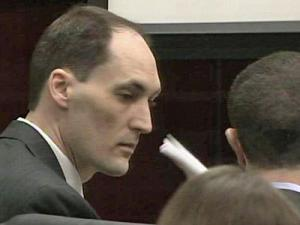 Brad Cooper speaks with his defense attorney, Howard Kurtz, during trial on March 28, 2011.
