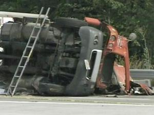A fully loaded tractor-trailer carry paper products flipped Saturday afternoon on northbound Interstate 85 near the U.S. Highway 70 split.