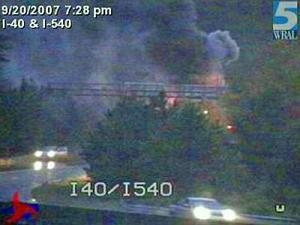 A tractor-trailer caught fire on the ramp from I-540 to I-40 East on Thursday, Sept. 20, 2007. The ramp was blocked for a time. No major delays were reported, however.