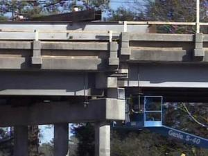 Crews use hydraulic jacks to lift sections of I-95 bridges off their supports and insert galvanized steel blocks to increase the height of the overpass.