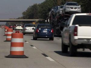 State transportation engineers have closed off a westbound lane of Interstate 40 near the Clayton Bypass to see whether that would ease traffic congestion.