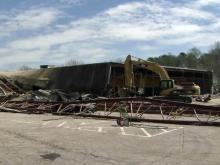 Demolition crews tore down an old bowling alley on Capital Boulevard Monday to make way for a park that city leaders hope will beautify the main gateway into Raleigh's downtown.