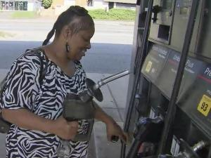 Sheila Harris was able to fill up with a smile after finding some of the lowest prices in the Triangle in south Raleigh Friday.