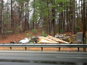 A truck overturned on eastbound U.S. Highway 64 Monday morning, blocking traffic near the Rolesville exit. (Tara Lynn / WRAL)