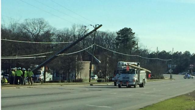 U.S. Highway 401 (Fayetteville Road) near Garner was closed in both directions Friday afternoon near Ten Ten Road after a damaged power pole toppled and loomed across the travel lanes.