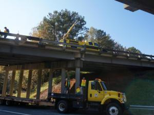 A serious wreck shut down lanes on Interstate 85 and U.S. Highway 70 near Hillsborough on Friday, Oct. 31, 2014. State troopers said the driver of a semi lost control and flipped over the interstate bridge railing, landing on the embankment below.