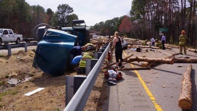 A log truck overturned on U.S. Highway 1 in Moore County Monday afternoon, blocking travel in both directions just south of Midland Road. (Photos by Frank Staples)